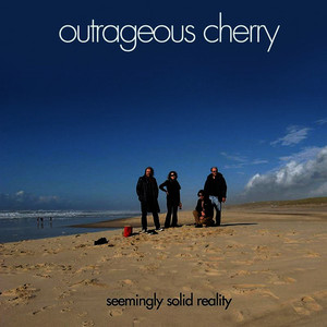 Albumcover Outrageous Cherry - Seemingly Solid Reality